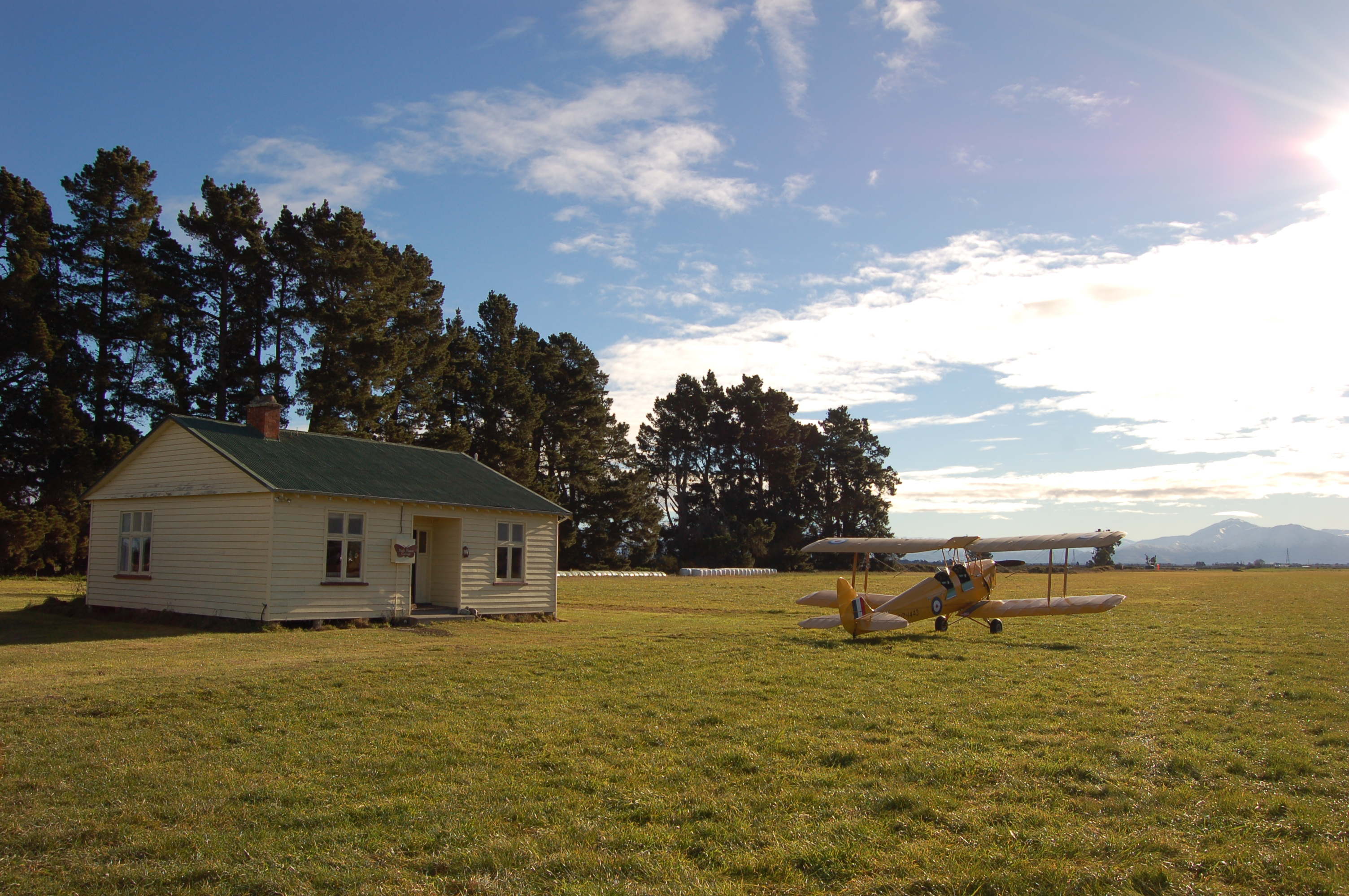 Cottage with Tiger Moth and Runway